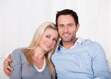 Affectionate couple relaxing on a sofa Royalty Free Stock Photography