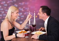 Affectionate couple in restaurant Royalty Free Stock Photos