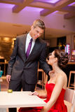 Affectionate couple in a restaurant Stock Photography