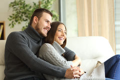 Affectionate couple resting at home Royalty Free Stock Images