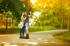 Affectionate couple on rollerblades Royalty Free Stock Images