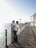 Affectionate Couple By The Sea On Pier Royalty Free Stock Photos