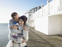 Affectionate Couple By The Sea On Pier Stock Images