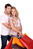 Affectionate couple with shopping bags Stock Images