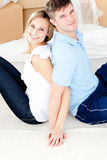 Affectionate couple sitting on the floor Stock Photos