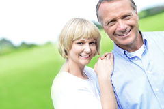 Affectionate couple smiling at camera royalty free stock image