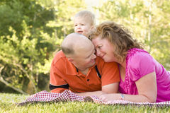 Affectionate Couple with Son in Park Royalty Free Stock Photo