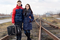 Affectionate couple standing a railway line Royalty Free Stock Images