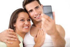 Affectionate couple take photo by mobile phone Royalty Free Stock Photography