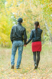 Affectionate couple taking walk in autumn park Stock Photography