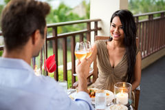 Affectionate couple toasting their love. On romantic dinner Stock Photos