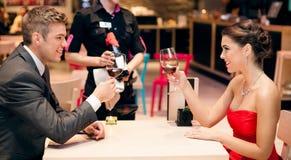 Affectionate couple toasting Stock Photos