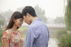 Affectionate Couple Touching Heads By a Canal Stock Photos