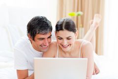 Affectionate couple using a laptop Stock Image