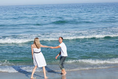 Affectionate couple walking at the seaside Stock Photos
