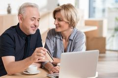 Affectionate couple wanting to buy something online and pay. With credit card royalty free stock photos