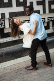 Affectionate dancer Outdoors. A charming couple dancing affectionately. A beautiful decorated background can be seeen in this image Stock Photo