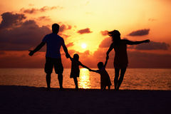 Affectionate family on the beach Royalty Free Stock Photography