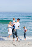Affectionate family having fun at the beach Royalty Free Stock Photo