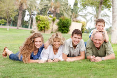 Affectionate family lying in the park Royalty Free Stock Photo