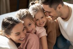 Free Affectionate Family Of Four Enjoying Sweet Tender Weekend Moment. Stock Image - 178124541