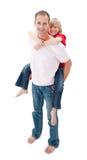 Affectionate father giving his son piggyback ride Stock Photos