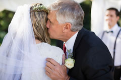 Affectionate father kissing his daughter. During wedding royalty free stock photo