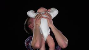 Affectionate father playing with baby son - lifting him up and making him laugh. Black. Close up. Affectionate father playing with baby son - lifting him up and stock video footage