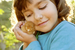 Affectionate Girl Holding Chicken in Hands Like a Treasure Royalty Free Stock Images