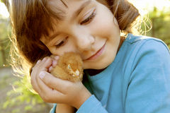 Affectionate Girl Holding Chicken in Hands Like a Treasure Royalty Free Stock Photos