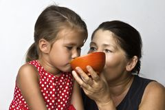 Affectionate grandmother and her cute little granddaughter Royalty Free Stock Photo