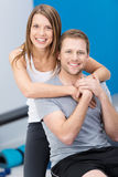 Affectionate health conscious young couple Stock Photos