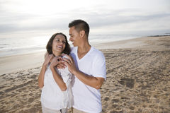 Affectionate Hispanic couple standing on beach Royalty Free Stock Photography