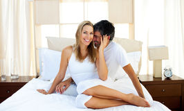 Affectionate lovers embracing on bed Royalty Free Stock Photography