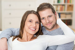 Affectionate loving young couple relaxing at home stock image