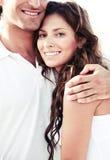Affectionate man embracing lady Stock Photos