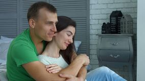 Affectionate man embracing woman from behind stock video