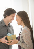 Affectionate Man Giving Birthday Gift To Woman Stock Photography