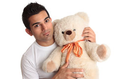 Affectionate man holding bear Stock Photo