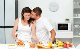 Affectionate man kissing his girlfriend Stock Photography