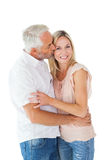 Affectionate man kissing his wife on the cheek Stock Images