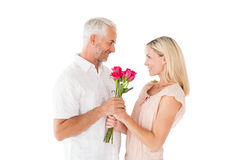 Affectionate man offering his partner roses Stock Images
