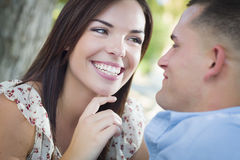 Affectionate Mixed Race Romantic Couple Portrait in the Park Stock Photo