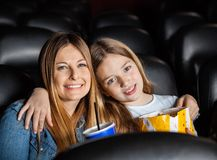 Affectionate Mother And Daughter In Theater Royalty Free Stock Image