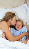 Affectionate mother kissing her daughter Royalty Free Stock Photo