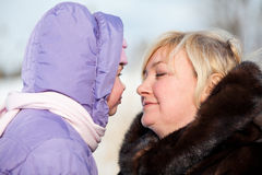 Affectionate mother with small child in winter warm clothes Royalty Free Stock Photo