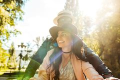 Affectionate multicultural walking together in a park in a. Sunny day royalty free stock photo