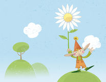 Affectionate pixie holding a flower Royalty Free Stock Photography