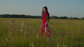 Mom and toddler girl walking in nature at sundown