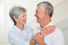 Affectionate retired couple smiling at each other Royalty Free Stock Photos